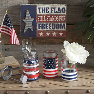 Three mason jars with red, white, and blue stripes and stars on themThree mason jars with red, white, and blue stripes and stars on them photo