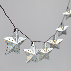 Metal star LED string lights with smaller stars punched into them photo