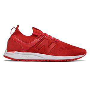 Red New Balance tennis shoes with mesh sides photo
