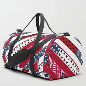 Red white and blue striped duffle bag with stars and stripes diagonally all over photo