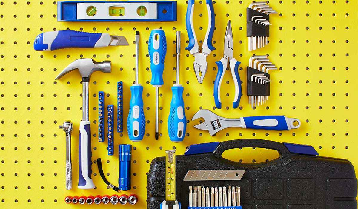Several blue and silver tools on yellow pegboard