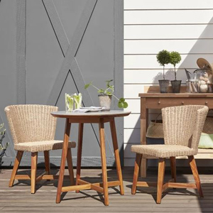Small round wooden table with two wicker chairs. photo