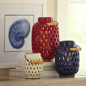 Tall red, medium blue, and short white lanterns with distressed finish photo