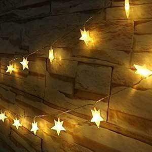 Indoor/outdoor star-shaped string lights in warm white photo
