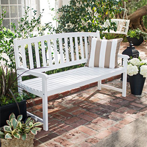 White wooden bench withstraigh armrests, slatted back, and contoured seat photo
