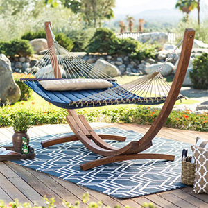 Navy double hammock hanging on an arched wooden bar photo