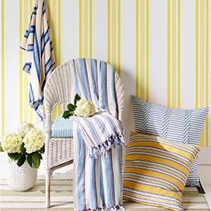Blankets, pillows, and wallpaper with ticking stripes pattern photo