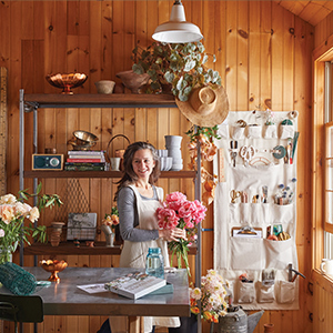Woman inside her decor and plant shop photo