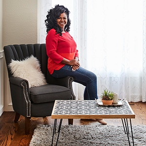 Woman sitting in front of DIY coffee table photo