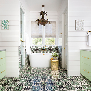 Bathroom remodel with mint green vanities, pattern tile, and freestanding tub photo