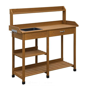 Wooden potting bench with a drawer and multiple shelves photo