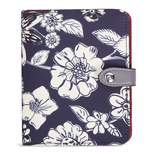 Indigo Vera Bradley passport wallet with white flowers on it with a silver metallic closure photo
