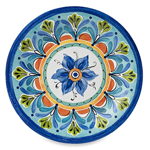 A multi-colored plate that features a hand-painted look in a colorful floral pattern. photo