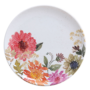 White melamine plate with a multi-color floral design on the bottom half of the plate. photo