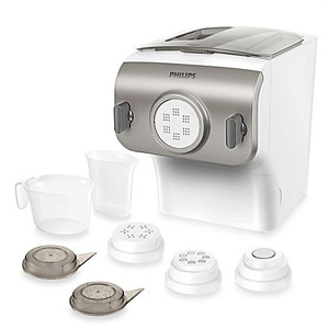 White and silver Philips pasta maker with seven accessories. photo