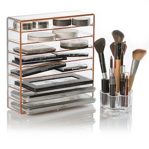 EllieZiar's Palette and Makeup Organizer with several shelves filled with makeup products along with a makeup brush holder photo