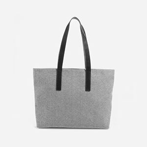Gray tote bag with black leather straps photo