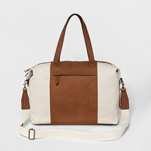 White canvas weekender with brown leather accents photo