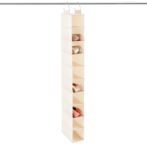 10-Compartment Natural Canvas Hanging Shoe Organizer with four pairs of shoes in the pockets photo