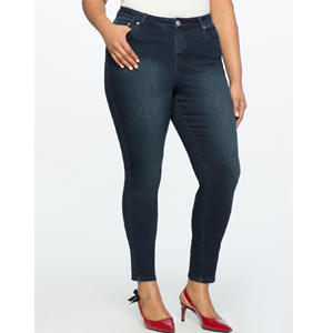 eloquii high-waisted jeans pair with a white top and red kitten heels photo