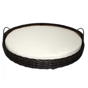 Rattan Round Dog Sofa with a handle on each side and a white cushion inside from Wayfair. photo