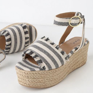 pair of grey and white striped platform sandals photo