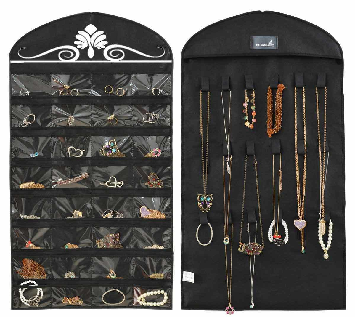 Black hanging jewelry organizer filled with a variety of jewelry photo