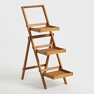 Natural wood plant stand with three tiers. photo