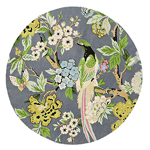 Gray and green toned round area rug with flowers and birds on it. photo