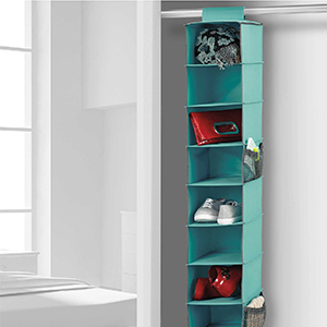 Aqua hanging shoe organizer with 10 shelves filled with a variety of accessories. photo
