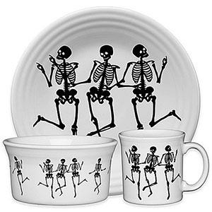 64fdf64a091 White dinnerware featuring a serving bowl, coffee mug, and small bowl with  black dancing