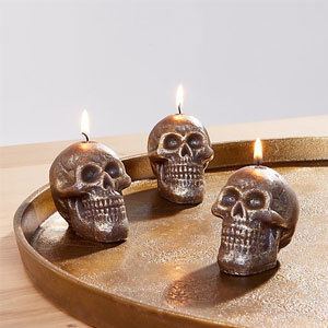 Three skull candles on a display photo