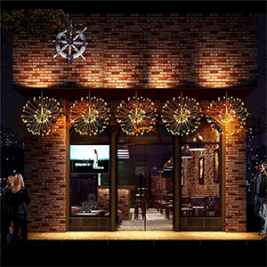 LED starburst pendant light for outdoor use from Amazon hanging on the front of a store photo