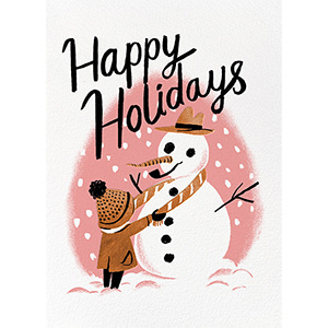 Happy Holidays Snowman Christmas E-card with a little child building a snowman with a pink background and black font photo