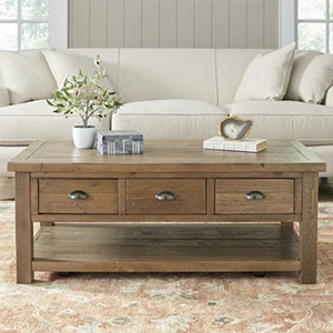 Rectangular coffee table made of pine featuring three drawers photo