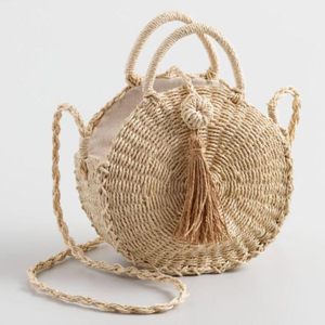 Round crossbody straw bag with one big tassel on the front. photo