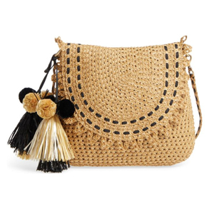 Woven shoulder bag with magnetic snap flap and pom-pom tassels. photo