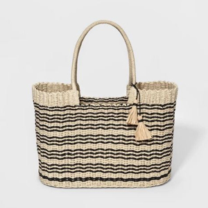 Straw tote with black stripes and tassel detailing. photo