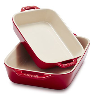 Two red and cream baking dishes. photo