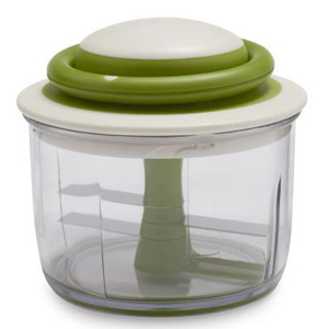 Green and white vegetable chopper. photo