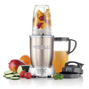 NutriBullet blender from Walmart filled with frozen fruits and ice with travel cup and lid surrounded by fresh veggies. photo