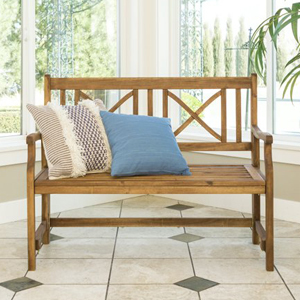 Wood folding bench from Walmart with two throw pillows in a room with a lot of windows photo