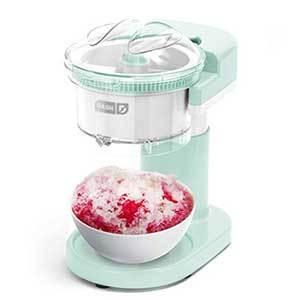 Mint green Shaved Ice Maker holding a white bowl of freshly shaved ice with red syrup photo