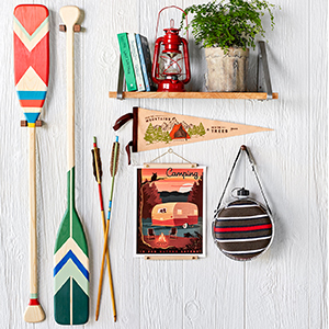 Camping gear including paddles, canteen, art, and flags photo
