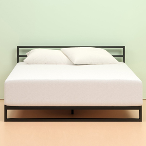 Zinus green tea mattress with pillows on black bed frame with a light green wall color. photo
