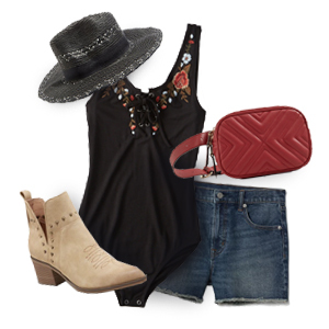 Black bodysuit styled with denim shorts, black straw hat, red belt bag, and tan ankle cowboy boots photo