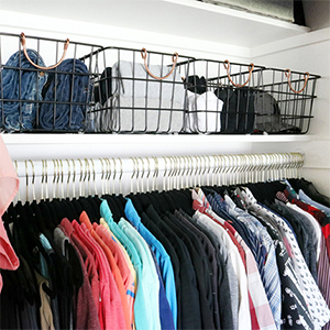 Wire baskets and flocked hangers for closet organization photo