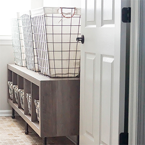 Storage shelf and wire hampers for laundry room storage photo