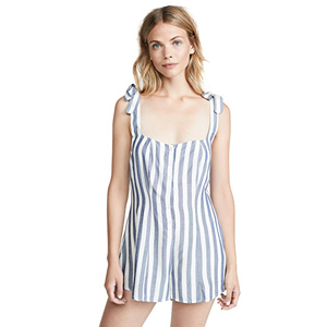 A woman wearing a blue and white striped romper cover-up. photo