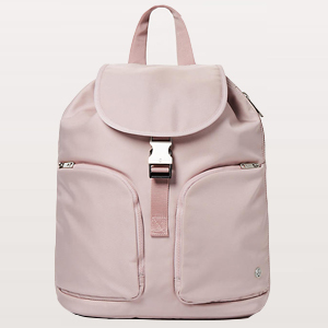 Blush backpack with fold over top buckle and two side pockets. photo